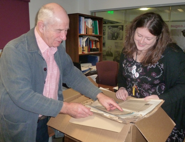 Duncan Scott and Assistant Archivist Lindsay Ince review some of his research material.