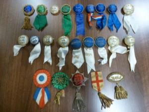 Membership pin badges of the Huddersfield Amateur Operatic Society, 1912-1938