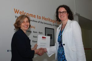 The University's Sarah Wickham (right) receives the certificate of Accreditation from The National Archives' Caroline Ottaway-Searle